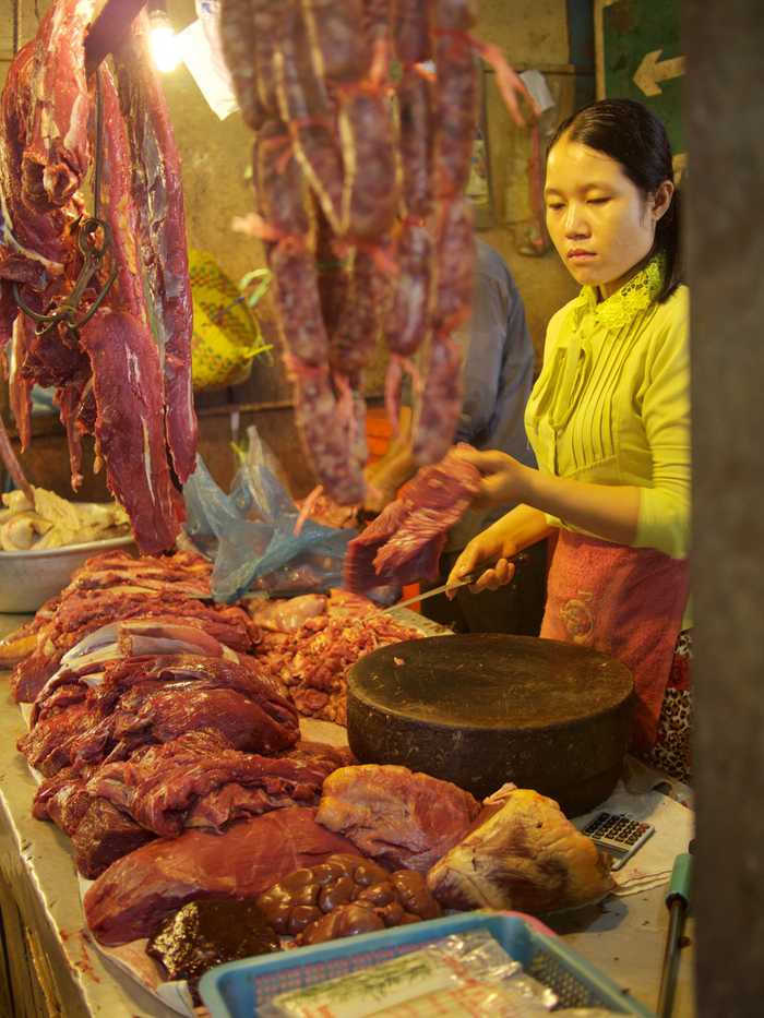A woman selling freshly butchered meat
