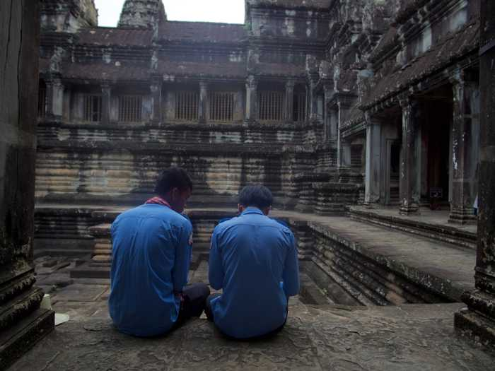 Security guards watching over ancient Angkor Wat pools